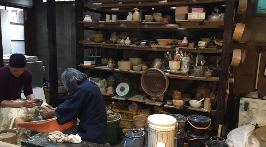 Pottery: Shelves of student work